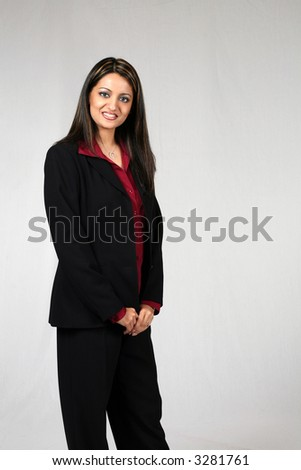 Full length of Beautiful Middle Eastern Business Woman isolated on white in suit