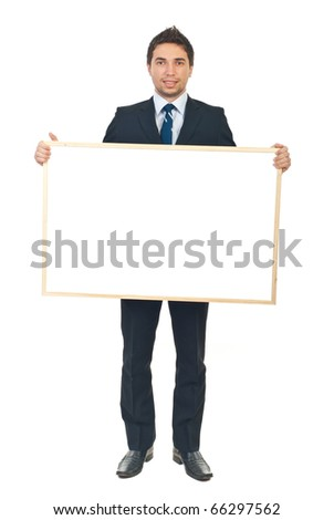 Full length of beauty businessman holding a blank banner isolated on white background - stock photo