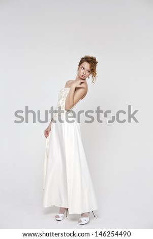 Full length of bride wearing luxurious wedding dress  - stock photo