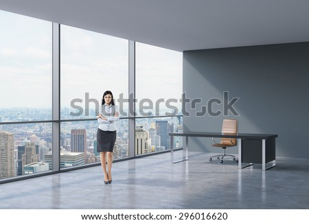 Full-length of brunette business lady in a workplace at modern corner panoramic office in New York, Manhattan. A concept of financial consulting services.