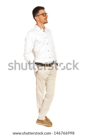 Full length of business man with eyeglasses standing with legs crossed and looking away isolated on white background