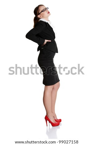 Full length of business woman with backache on white background - stock photo