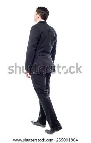 Full length of businessman going forward over white - stock photo