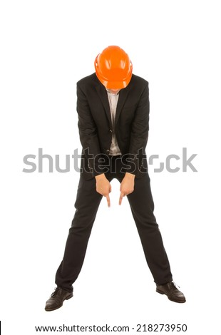 Full Length of Businessman Wearing Orange Hard Hat Pointing and Looking Down in Studio with White Background - stock photo