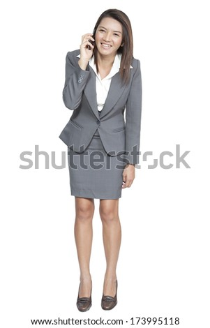 Full length of businesswoman asian gesture attractive standing enjoy talking on mobile phone, on white background - stock photo