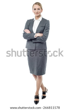 Full length of businesswoman with folded arms - stock photo