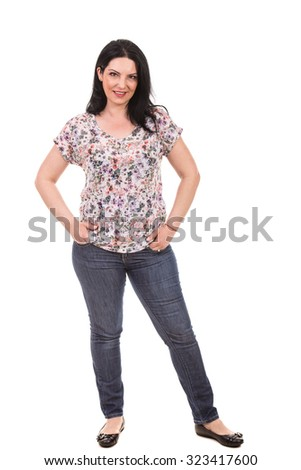 Full length of casual brunette woman isolated on white background - stock photo