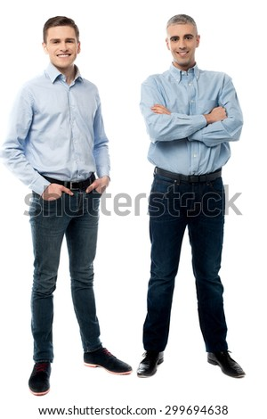 Full length of casual young men posing in style - stock photo