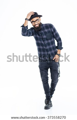 Full length of cheerful attractive african american man with beard in black hat and glasses standing