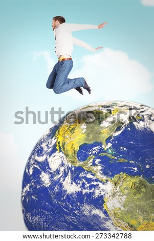 Full length of cheerful young man jumping against blue sky - stock photo