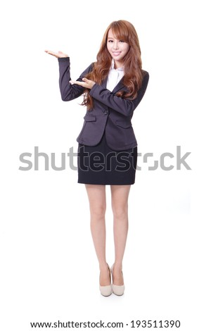 Full length of confident business woman showing something isolated over white background, model is a asian beauty - stock photo