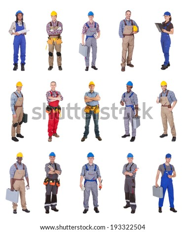 Full length of confident multiethnic engineers standing against white background - stock photo
