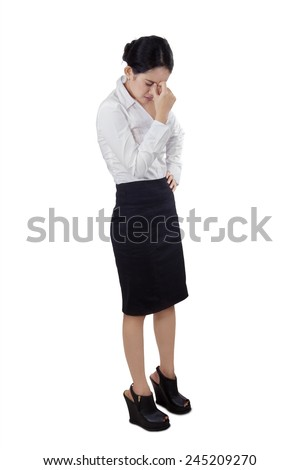Full length of entrepreneur having headache and touch her head, isolated on white background - stock photo