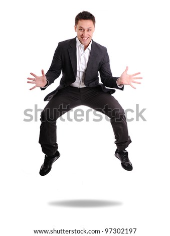 Full length of excited business man jumping
