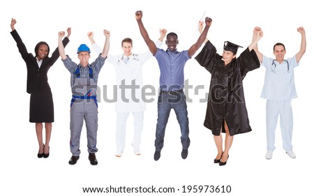 Full length of excited people with diverse occupations standing against white background