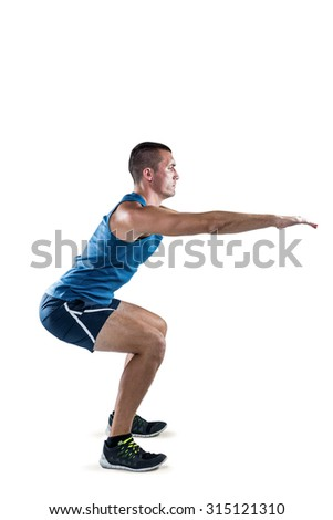 Full length of fit man doing squats on white background - stock photo