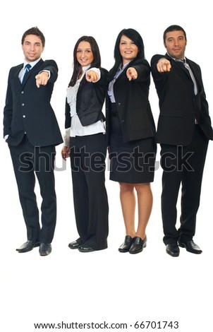 Full length of four business people in a row pointing  and chosen you to join their business isolated on white background - stock photo