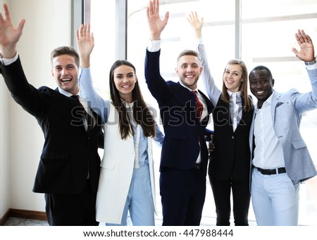Full length of group of happy young people in celebrating, gesturing, keeping arms raised and expressing positivity. - stock photo
