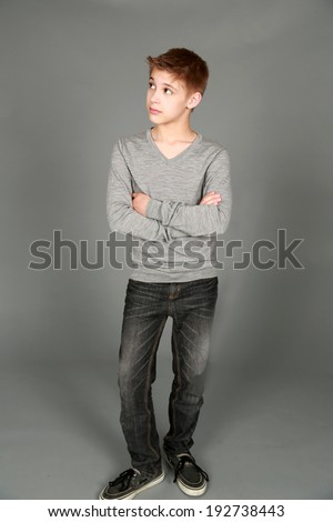 full length of handsome preteen boy looking to side