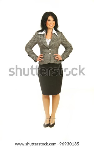 Full length of happy business woman standing with hands on waist isolated on white background - stock photo