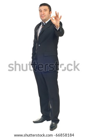 Full length of happy employee showing okay sign hand gesture isolated on white background - stock photo
