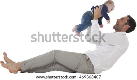 Full length of happy father playing with baby boy Young man with son spending leisure time Both are in casuals isolated over white background