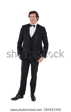 Full length of happy groom posing over white background