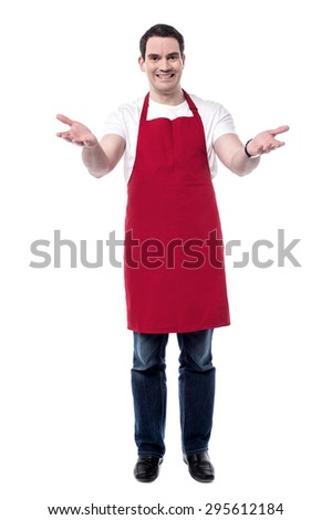 Full length of happy male chef with wide open arms.