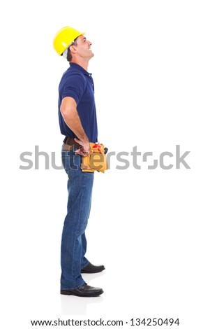 full length of happy repairman looking up isolated on white background - stock photo