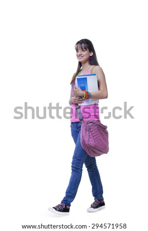 Full length of happy university student with books over white background - stock photo