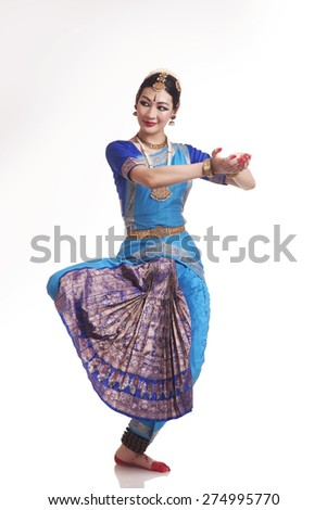 Full length of happy young woman performing Bharatanatyam over white background - stock photo