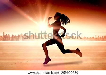 Full length of healthy woman jogging against sun shining over city - stock photo