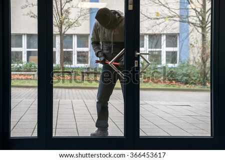 Full length of hooded man using crowbar to open glass door & Burglar Door Stock Images Royalty-Free Images \u0026 Vectors ... Pezcame.Com