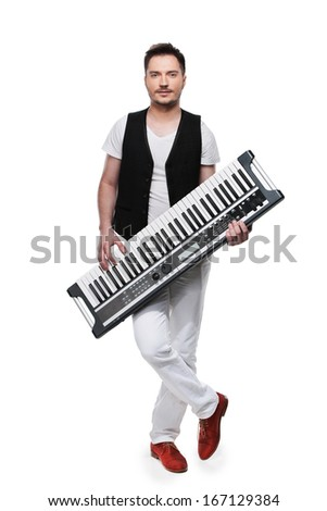 Full length of male musician with synthesizer. Standing isolated over white background  - stock photo