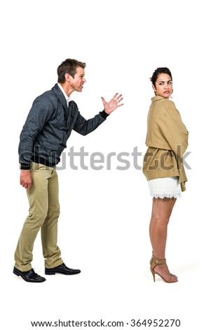 Full length of man arguing with girlfriend against white background