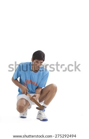 Full length of man in sportswear practicing hockey isolated over white background - stock photo