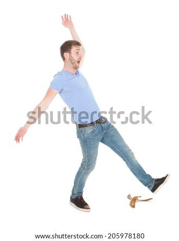 Full length of man slipping over white background - stock photo