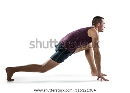 Full length of man stretching against white background