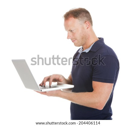 Full length of mid adult man using laptop over white background