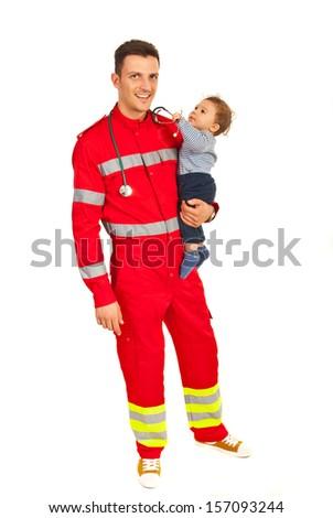 Full length of paramedic man holding baby boy isolated on white background - stock photo