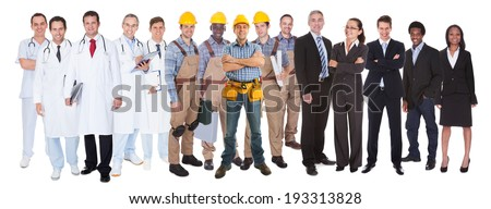 Full length of people with different occupations standing against white background - stock photo