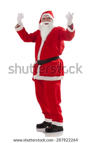 Full length of Santa Claus gesturing over white background - stock photo