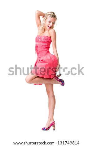 Full length of  sensual woman in short dress dancing against isolated white background - stock photo