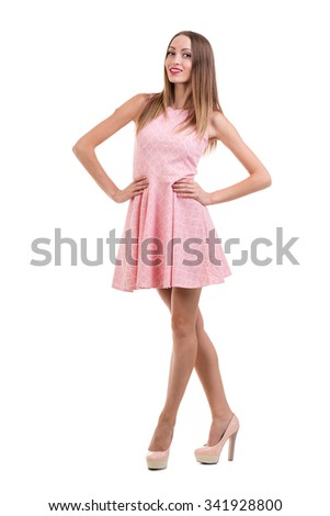 Full length of sensual woman in short dress posing against isolated white background - stock photo