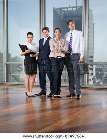 Full length of smart business executives posing - stock photo