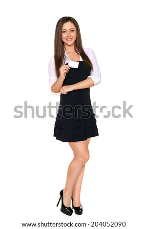 Full length of smiling business woman showing blank credit card isolated on white background - stock photo