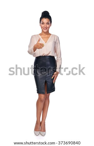 Full length of smiling business woman standing on white background and giving you a fake greeting - stock photo
