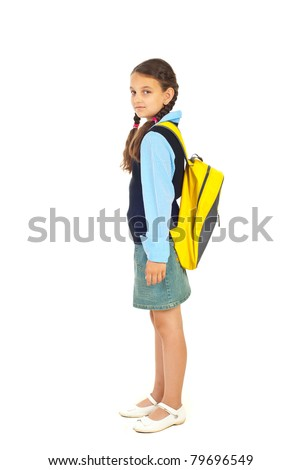 Full length of student girl standing in semi profile and looking at camera isolated on white background - stock photo