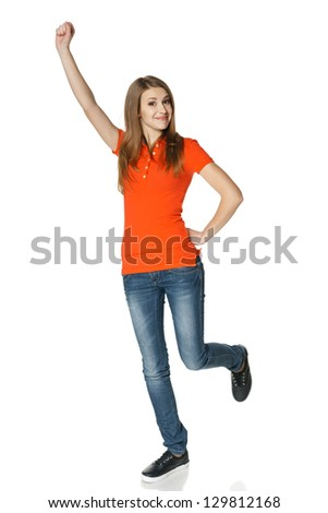 Full length of successful funny young female teenager in casual celebrating  triumph, isolated on white background