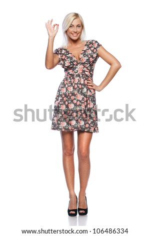 Full length of successful woman happy smiling showing OK sign, on white background.